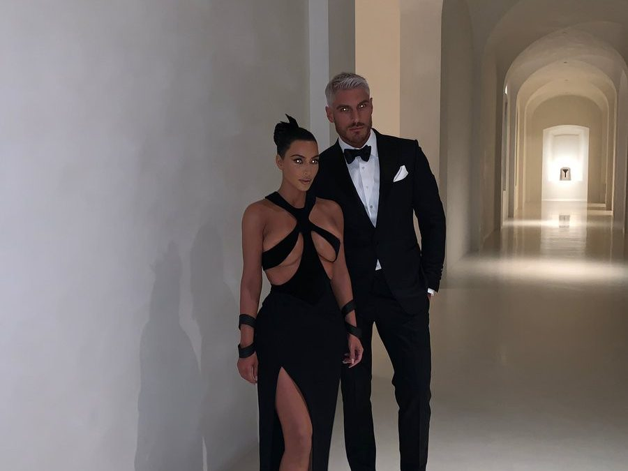 COVER YOURSELF: KIM KARDASHIAN AMAZED FANS WITH A NEW EVENING DRESS