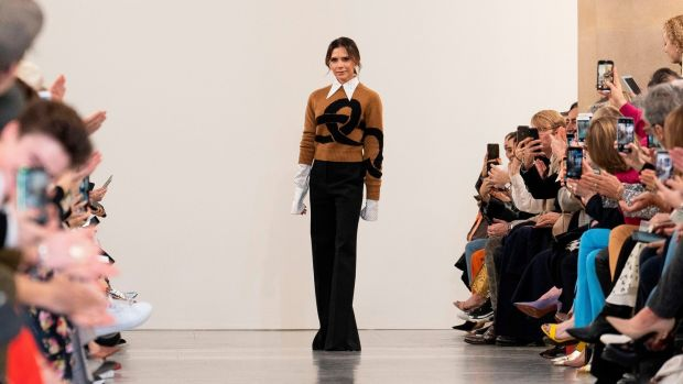 British designer Victoria Beckham acknowledges the crowd during her 2019 autumn/winter collection catwalk show at London Fashion Week. Photograph: Niklas Halle'n/AFP/Getty Images