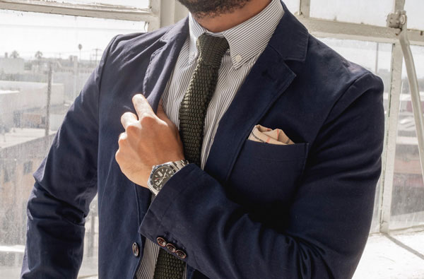 button down collar shirt with knit tie and blazer