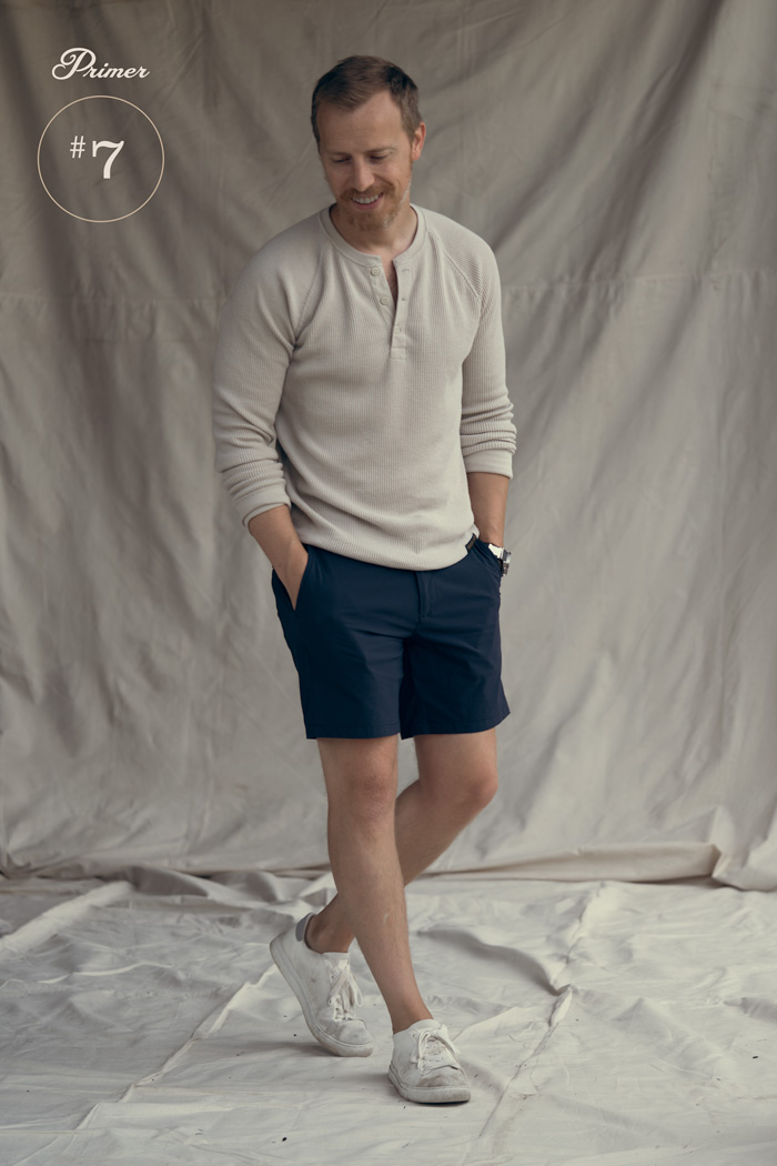 knit henley with tech shorts men outfit fashion