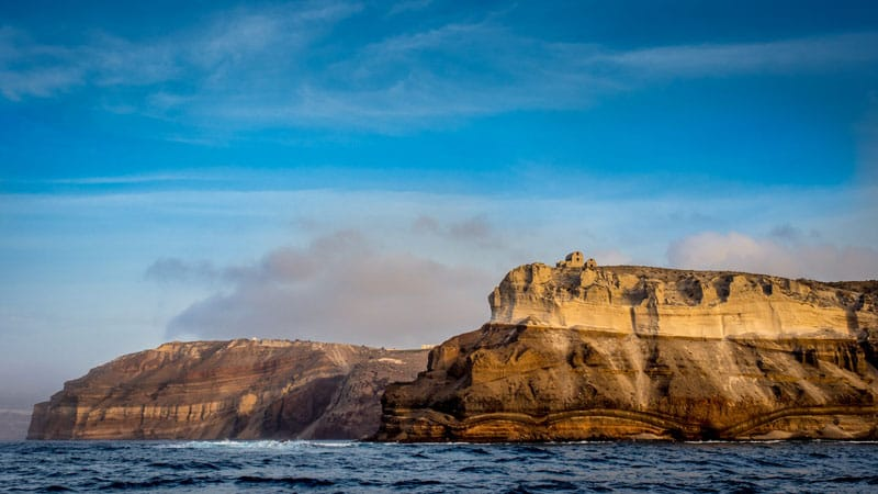 things to do in santorini | see akritori from the sea